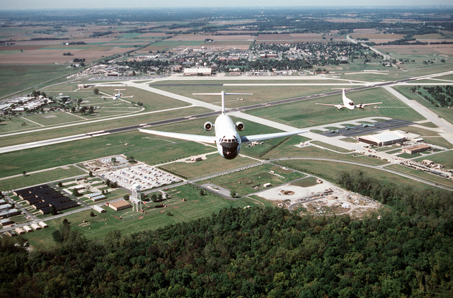 An air-to-air, front view of a McDonnell Douglas built C-9A Nightingale aircraft leading a formation that includes (left) a C-21A and a C-12F over the ramps and runways of Scott. All aircraft are assigned to the 375th Airlift Wing, Air Mobility Command