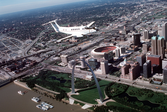 An air-to-air, three quarter front view of a Beech aircraft-built C-12F aircraft during a flight over the famous St. Louis Arch, on the banks of the Mississippi River, and Busch stadium. The C-12F is assigned to the 375th Airlift Wing, Air Mobility Command