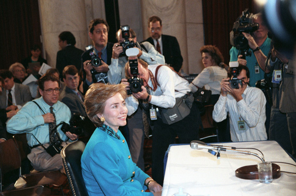 Photograph of First Lady Hillary Rodham Clinton Posing for Photographs at a Labor and Human Resources Hearing