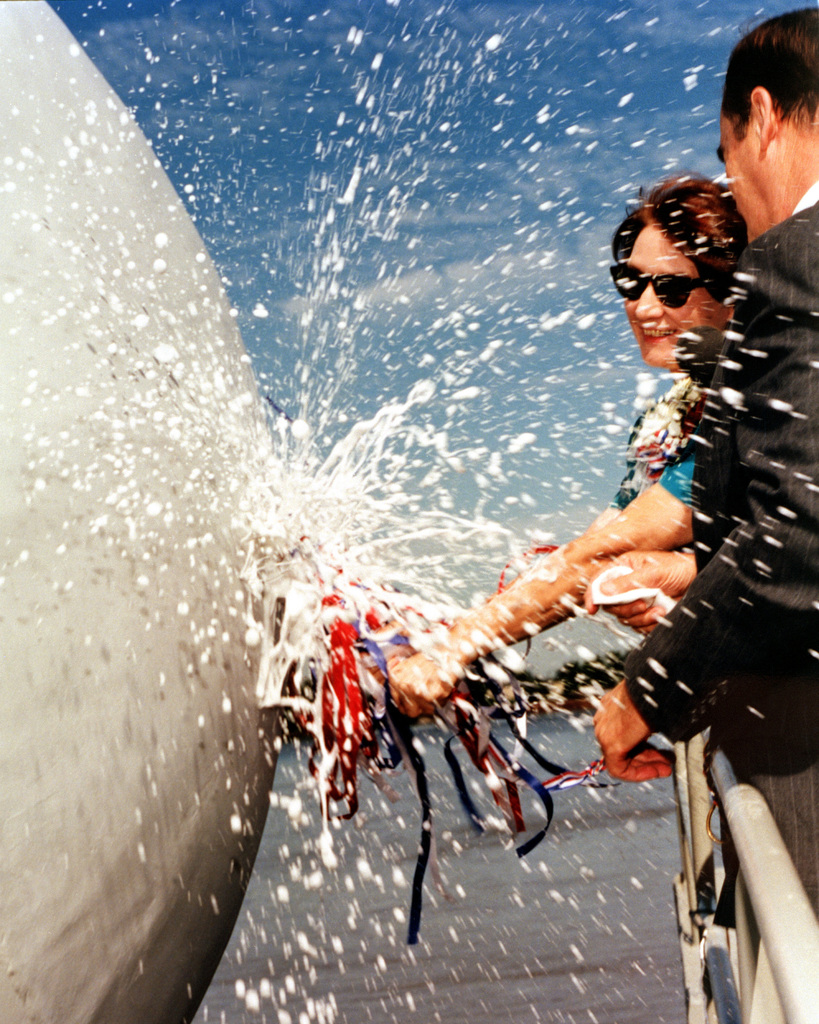 Mrs. Mary Elam Howard, ship's sponsor, breaks the traditional of champagne over the bow of the dock landing ship CARTER HALL (LSD-50) during the vessel's christening and launching ceremony