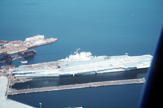 A port view of the aircraft carrier Coral Sea (CV-43) moored at Fairfield Terminal for scrapping by the Seawitch Salvage Co