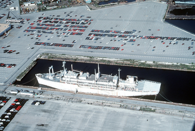 A port view of the former hospital ship SANCTUARY (AH-17) moored at the Maryland Port Authority pier at Lambert Point. Life International, the non-profit organization that obtained the ship from the Navy in 1990 for 15 dollars, has proposed a plan to use the ship as a shelter for homeless residents of Baltimore