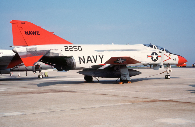 A right rear view of a QF-4N PHANTON II aircraft assigned to the Naval Air Warfare Center parked on the flight line