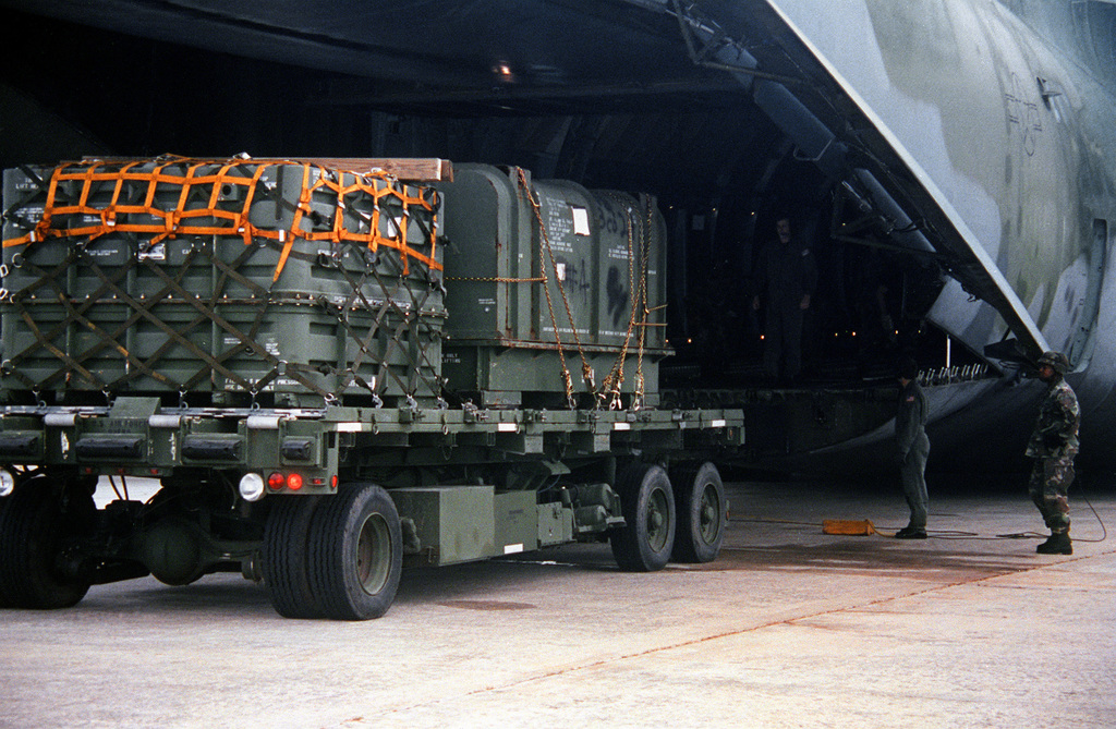 3rd Battalion 15th Infantry Regiment and 3rd Battalion 41st Field Artillery, 24th Infantry Division, loading equipment on an aircraft at Hunter Army Airfield, prior to deployment to Somalia