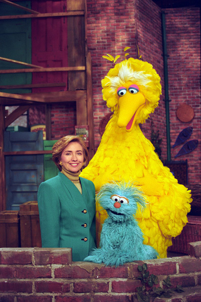 Photograph of First Lady Hillary Rodham Clinton Posing on the Big Bird Nest Set with Big Bird and Rosita to Celebrate the 25th Season of Sesame Street