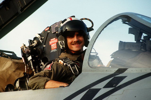 An F-14 Tomcat pilot of Fighter Squadron 102 (VF-102) waits in the cockpit of his aircraft for his turn to launch from the aircraft carrier USS AMERICA (CV-66) during Operation Deny Flight