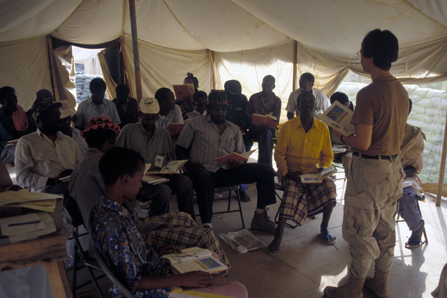 SPC. Holly Hyer of the 96th Civil Affairs Company, teaches basic English to Somalis at Hunter Base