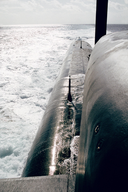 A view looking aft along the starboard side of the ballistic missile submarine USS NEBRASKA (SSBN-739) at the foamy wake as the ship heads out to sea from Cape Canaveral, Fla. to conduct a test firing of a Trident II fleet ballistic missile