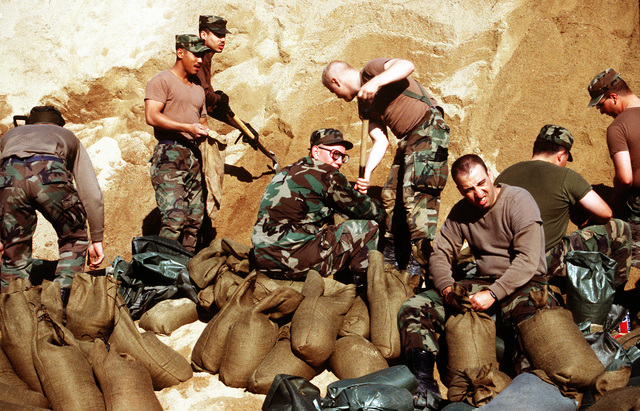 Members from the 51st Maintenance Squadron preparing sandbags.(Exact date unknown)