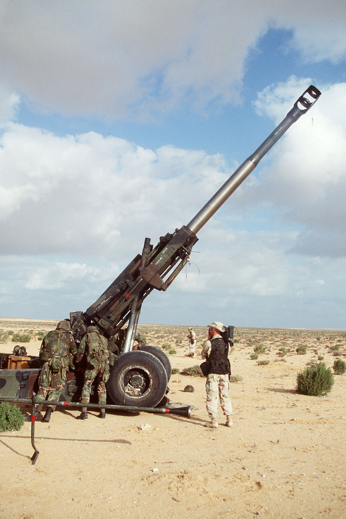 Members of the 24th Infantry Division, Fort Stewart, Georgia, conduct a live fire exercise in Egypt using a 155mm M198 Howitzer during Exercise BRIGHT STAR '94