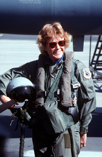 The first female Secretary of the Air Force Dr. Sheila Widnall, poses with a flight suit on
