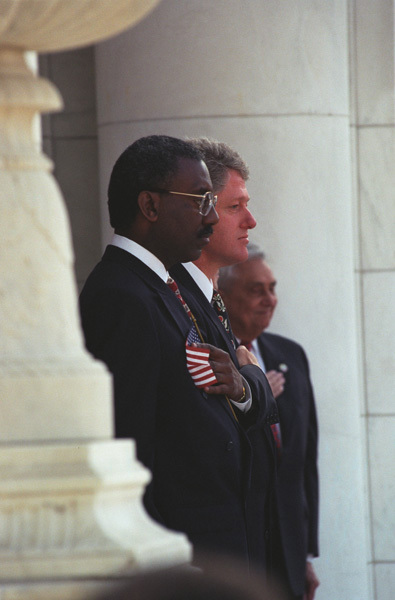 Photograph of President William J. Clinton and Secretary of Veterans Affairs Jesse Brown at the Veterans Day Ceremony in Arlington, Virginia