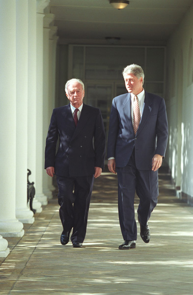 Photograph of President William J. Clinton and Prime Minister of Israel Yitzhak Rabin Walking Along the Colonnade of the White House