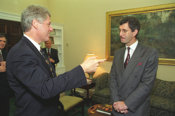 """Photograph of President William J. Clinton and Irish Deputy Prime Minister Dick Spring in the Office of Anthony """"Tony"""" Lake at the White House"""