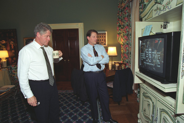 Photograph of President William J. Clinton and Vice President Albert Gore Watching the Results of the North American Free Trade Agreement (NAFTA) Vote in the Private Residence at the White House