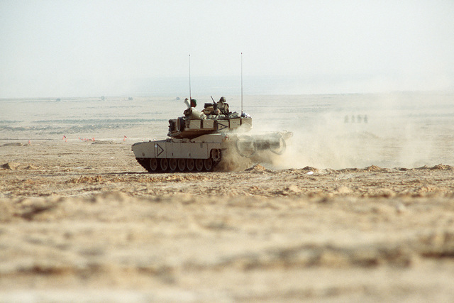 Members of the 24th Infantry Division, Fort Stewart, Georgia, conduct a live fire exercise in Egypt using an M1A1 Abrams Main Battle Tank (MBT) during Exercise BRIGHT STAR '94