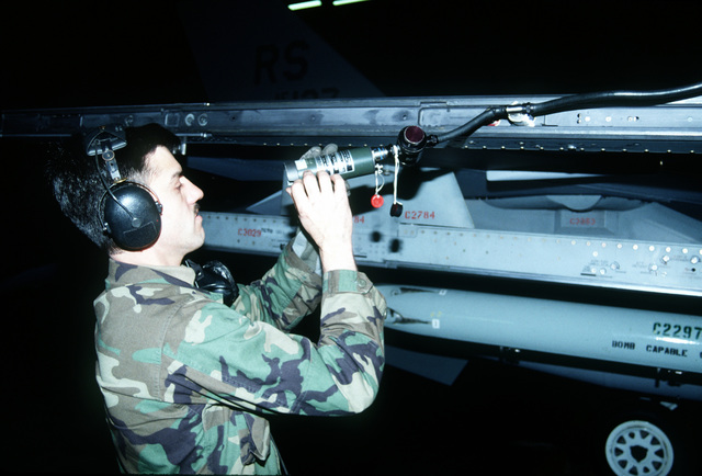 SGT. Messer, an F-16 weapons specialist, inspects an Aim 9 air-to-air missile cannon plug prior to weapons uploading on a 526th Fighter Squadron F-16. F-16 aircraft maintainers from the 526th Fighter Squadron perform routine tasks preparing aircraft for training flights scheduled for the afternoon