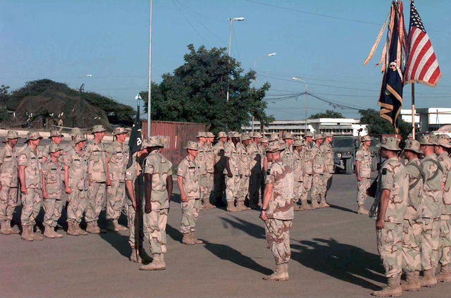 US Marines stand at attention in formation inside the university compound, Mogadishu, Somalia. The 2nd Battalion, 14th Infantry, Bravo Company, received the Combat Infantry Badge for their participation in a firefight in September in Mogadishu. The C.I.B. is the most coveted award that an infantryman can receive. This mission is in direct support of Operation Restore Hope