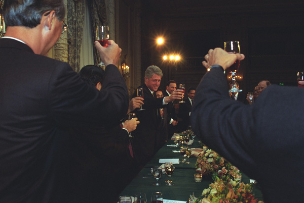 Photograph of President William J. Clinton Having a Toast with Asia-Pacific Economic Cooperation (APEC) Leaders at the Four Seasons Hotel in Seattle, Washington