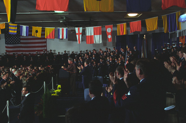 Photograph of President William J. Clinton Addressing the U.S. Coast Guard in the Tennis Courts Building at Pier 36 in Seattle, Washington