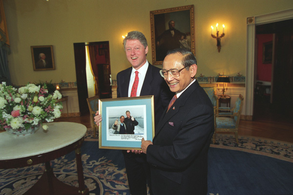 Photograph of President William Jefferson Clinton and President Fidel Ramos of the Philippines in the White House Holding a Signed Photograph of both President Clinton and President Ramos