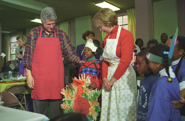 Photograph of President William Jefferson Clinton and First Lady Hillary Rodham Clinton Receiving a Thanksgiving Day Wreath from Children at the Covenant Baptist Church in Washington, D.C.