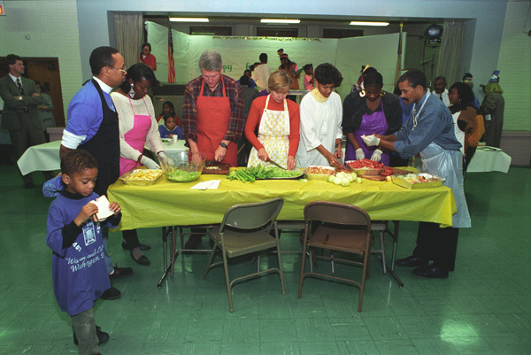 Photograph of President William Jefferson Clinton and First Lady Hillary Rodham Clinton Helping with Thanksgiving Day Food Preparation at the Covenant Baptist Church in Washington, D.C.