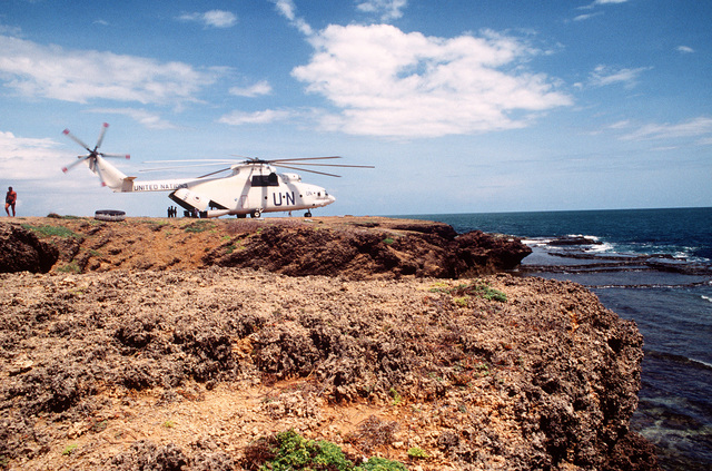 A Russian made Mi-26 Halo helicopter on the shores of Kismayo, Somalia. The Mi-26 Halo is used to shuttle supplies and personnel to areas outside Mogadishu during Operation CONTINUE HOPE