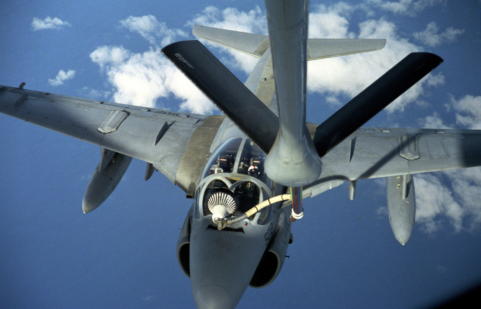 A US Navy (USN) A-6E Intruder connects with the refueling drogue from the boom of a US Air Force (USAF) KC-135 Stratotanker
