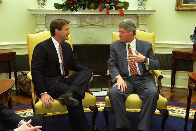 Photograph of President William Jefferson Clinton Meeting with Governor Evan Bayh of Indiana in the Oval Office at the White House