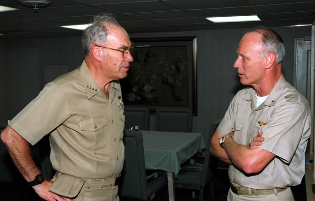 Rear Admiral Bernard J. Smith, Commander, Carrier Group Five (CVG-5) talks with Admiral Frank B. Kelso II, CHIEF of Naval Operations, aboard the aircraft carrier USS INDEPENDENCE (CV-62) in the Gulf of Oman during Operation Southern Watch