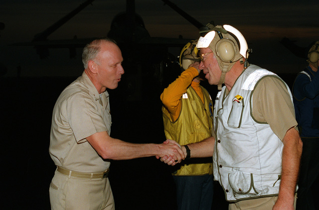 Rear Admiral Bernard J. Smith, Commander, Carrier Group Five (CVG-5) welcomes Admiral Frank B. Kelso II, CHIEF of Naval Operations, aboard the aircraft carrier USS INDEPENDENCE (CV-62) in the Gulf of Oman during Operation Southern Watch