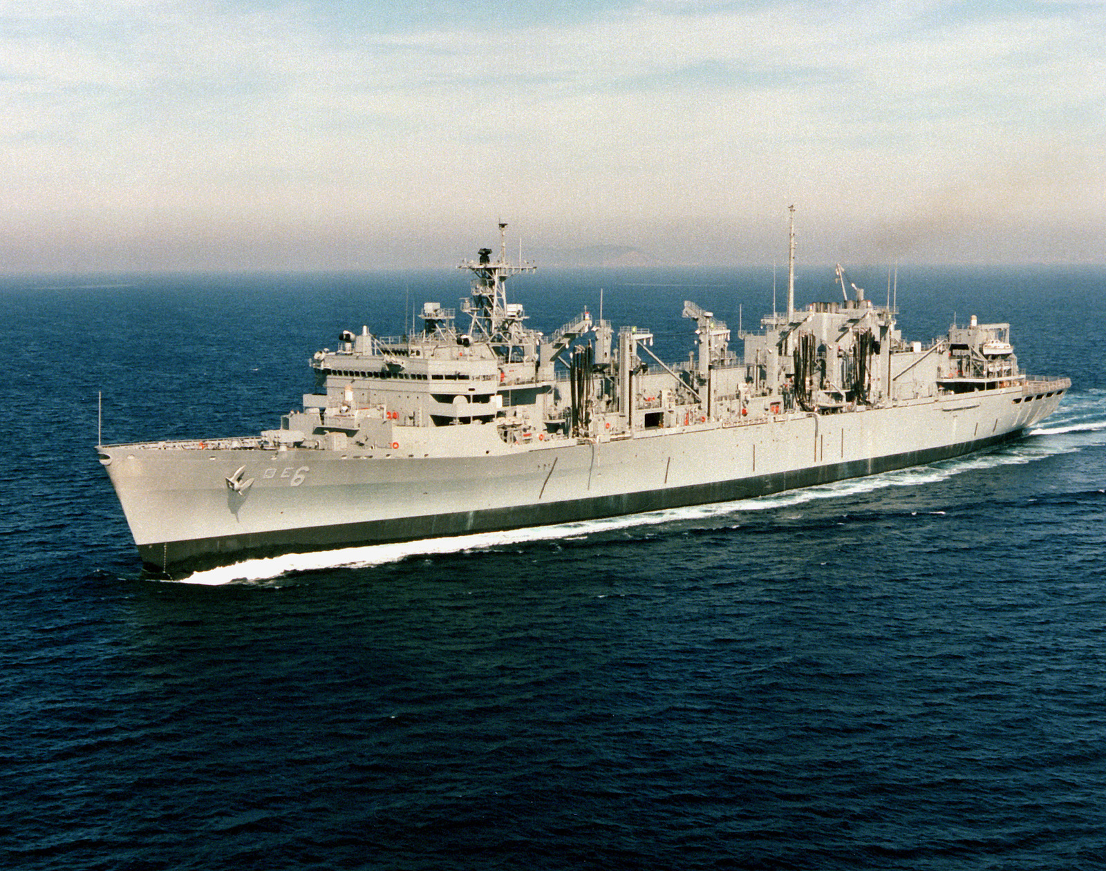 https://cdn10.picryl.com/photo/1993/12/14/port-bow-view-of-the-fast-combat-support-ship-uss-supply-aoe-6-underway-on-9f28ac-1600.jpg