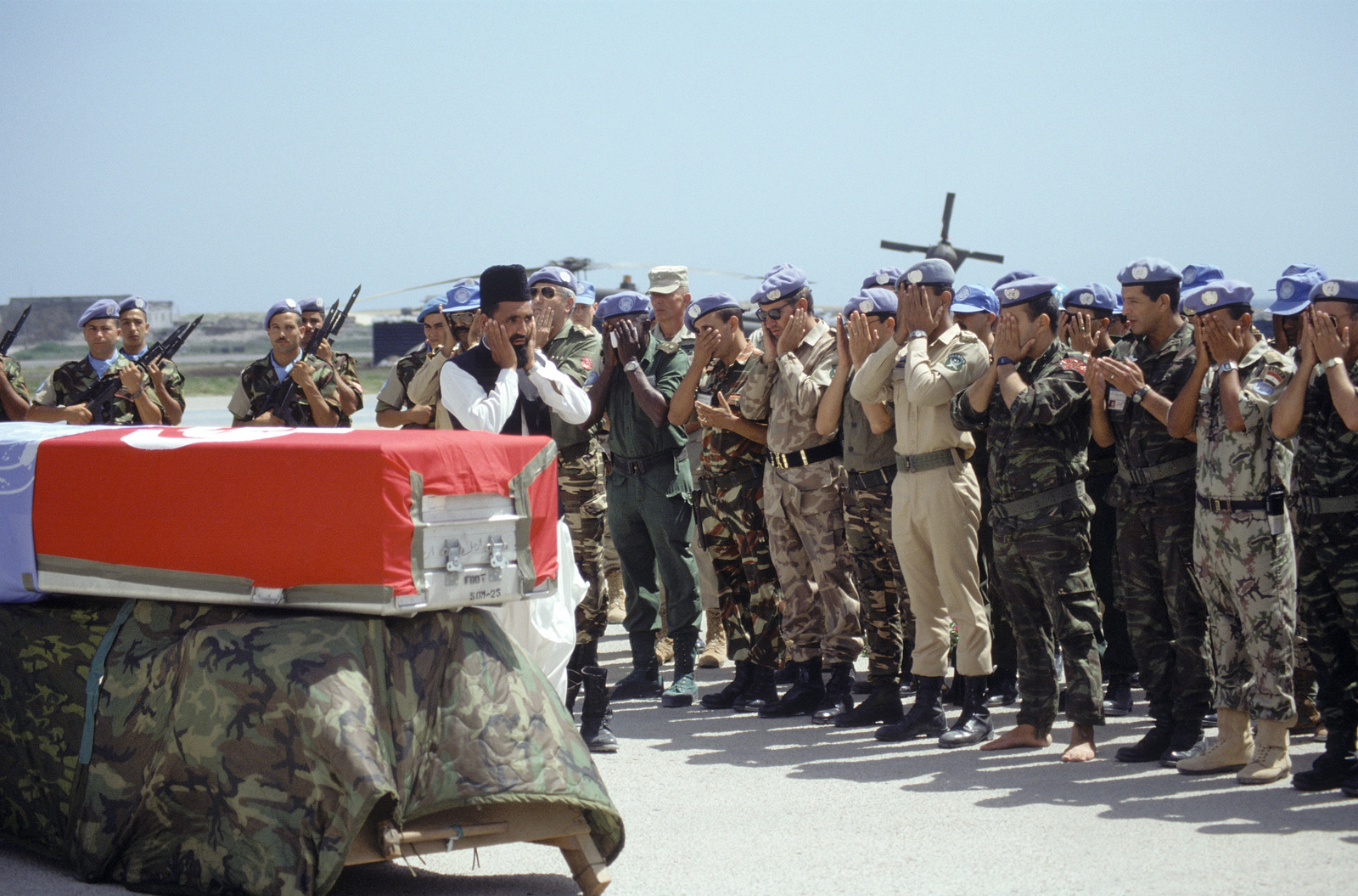A Tunisian priest performs the memorial service for a fallen soldier killed in Somalia. The soldier was killed when an American M-60 machine gun accidentally discharged during convoy operations