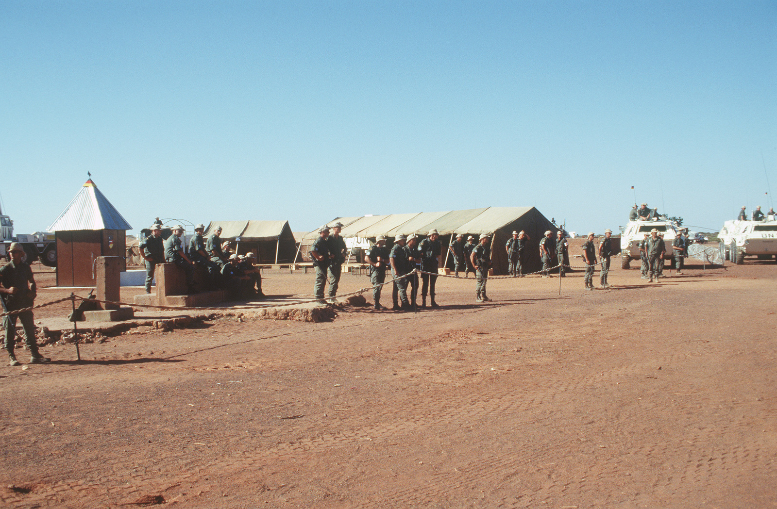 The German Army prepares for a well dedication ceremony; their 2nd Contingent dug the well during UNOSOM II. German Defense Minister Voelker Ruehe was on hand to dedicate the well
