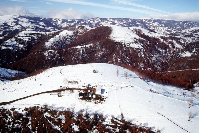 An aerial view of Observation Post 57 showing it's location on a Macedonian mountain top during Operation Able Sentry