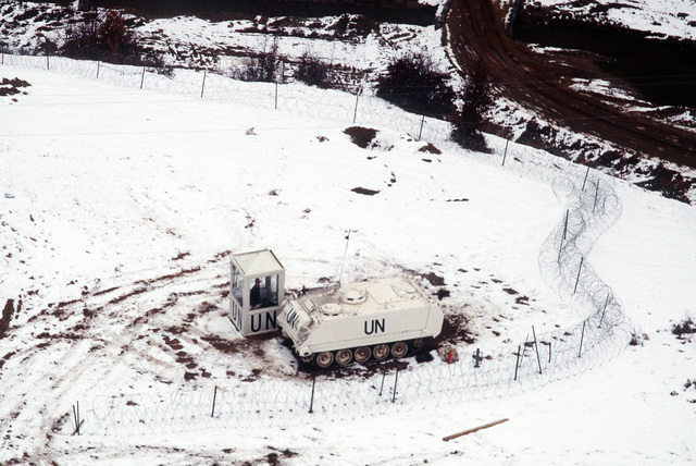 An aerial view of the observation booth and Armored Personnel Carrier at Observation Post 56a on the hill above Observation Post 56 in Macedonia