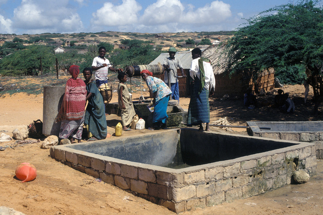 Somalis gather to draw from a well in the village. The Moroccan Army maintains a base in Marka