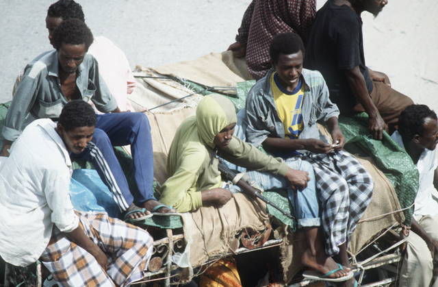 Somalis wait outside the Bangladesh Army compound to try to obtain a day's work. The Bangladeshis operate a food-for-work program during their support for UNOSOM II
