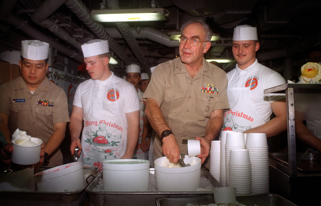 Admiral Frank B. Kelso, II, CHIEF of Naval Operations, assists Lieutenant Commander Jesus Malgapo, service officer and Mess SPECIALIST Second Class (MS2) Milo Moreno serving ice cream to a crew member of the aircraft carrier USS INDEPENDENCE (CV-62) during an ice cream social on the mess deck. The INDEPENDENCE is deployed in the Gulf of Oman in support of Operation Southern Watch