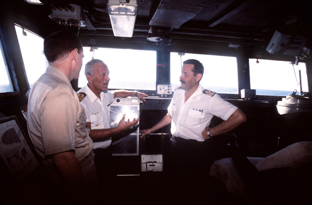 CAPT Kevin J. Cosgriff, USN, Commander, Cruiser Destroyer Squadron 32, speaks with Argentine Navy Commander Carlos Peralta, Commanding Officer of the corvett ARA Granville, on the bridge of the Argentine warship. The commander to the right is the Granville's Liaison Officer to Commander, Join Task Group 120.1. The ARA Granville has joined Operation Support Democracy and implies Argentina's desire to integrate itself with the multinational force, to be an instrument of democracy