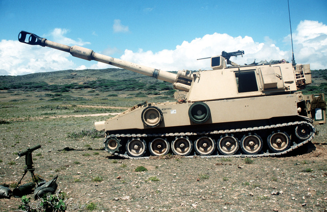 An M109, 155 mm self-propelled howitzer of C Battery, 1ST Battalion, 41st Field Artillery, Fort Stewart, Georgia, sits on Range No. 6. The unit took part in a joint training session with the Marine Corps' Charlie Company, 1/11th Artillery, Camp Pendleton, California, and their M198, 155 mm towed howitzer. Both units are in Somalia to support UNOSOM II