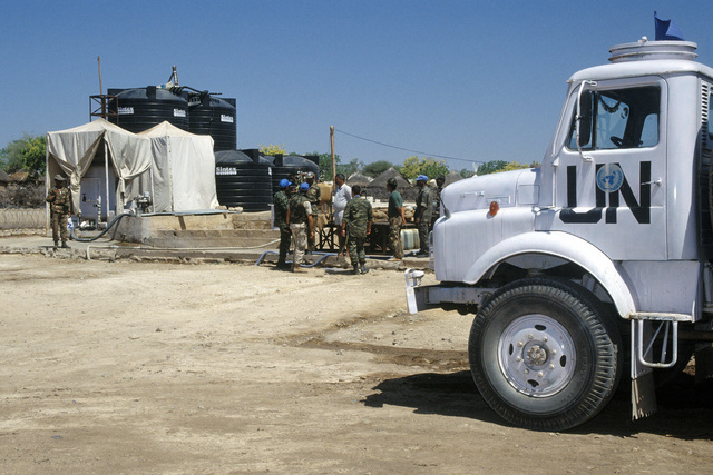 Hellenic (Greek) Army soldiers arrive at a water purification plant in Waajid, which is run by the Indian Army. The Greeks operate a field hospital as part of UNOSOM II