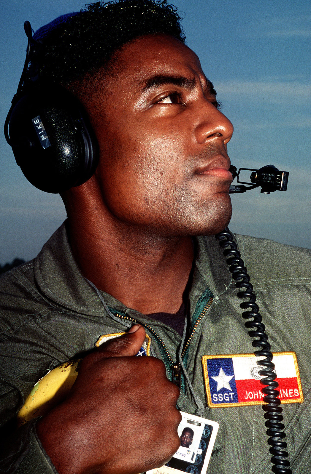 A close up view of STAFF SGT. John Gaines, aircraft electrician, of the 68th Aerial Port Squadron, Kelly AFB, TX, in headset.(Exact date unknown)