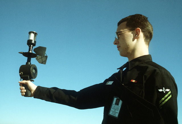 Aerographer's Mate AIRMAN Apprentice (AGAA) Mathew Bowden uses a hand held wind measuring gauge called a PMQ3 to record wind speed and direction. AGAA Bowden is attached to Naval Air Station North Island operations division