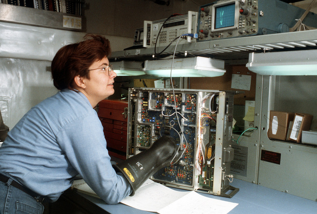 Electronics Technician Second Class (ET2) Lisa Overton is shown testing signals of a signal generator on board the destroyer tender USS CAPE COD (AD-43)