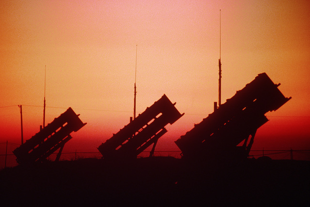 U.S. Army Patriot missiles are silhouetted against the setting sun near Kunsan Air Base during the training exercise. Exact Date Shot Unknown