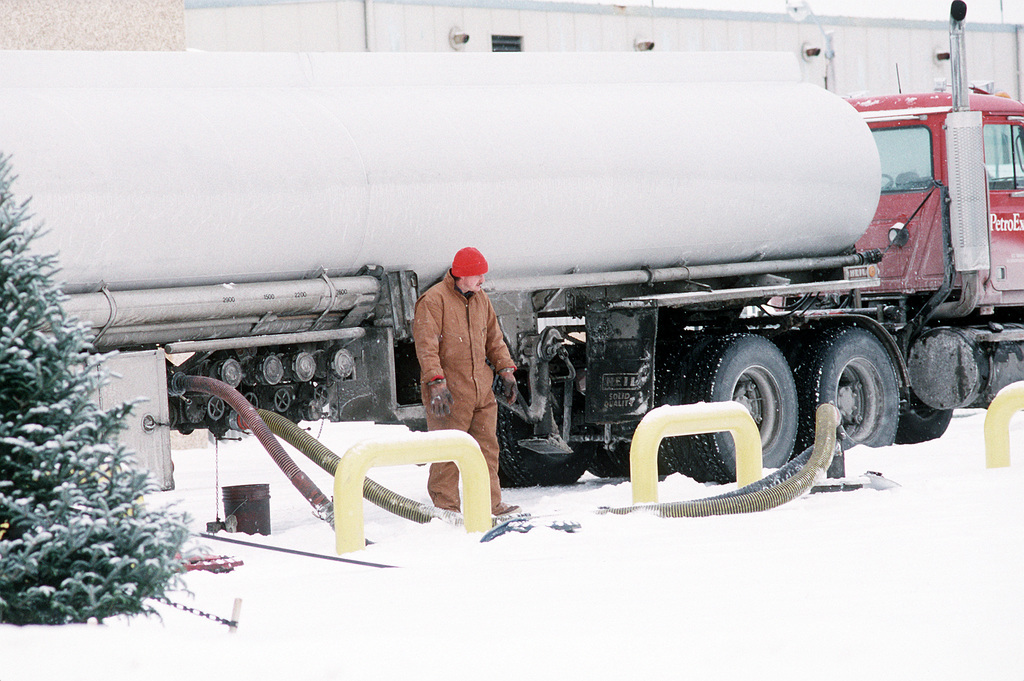 Despite the inclement weather, a fuel truck still makes a delivery of JP-5 jet fuel to Naval Air Station Brunswick