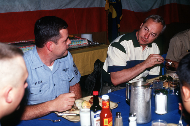 During a recent visit, Secretary of the Navy John H. Dalton enjoys lunch on the mess decks with crew members of the nucelar-powered aircraft carrier USS CARL VINSON (CVN-70). The ship is conducting carrier qualifications off the coast of southern California