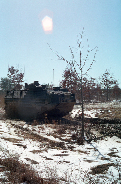 An Assault Amphibian Vehicle (AAV7A1) from CLNCs 2nd AAV Battalion moves through thick road mud at Fort AP Hill, Virginia